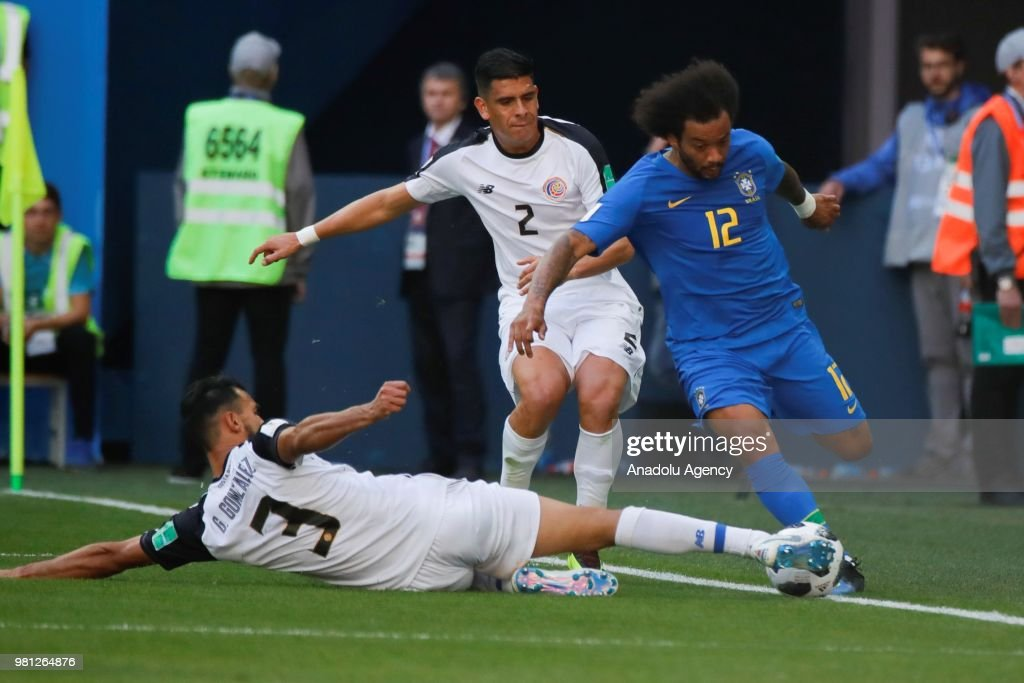 Marcelo of Brazil vies with Jo...