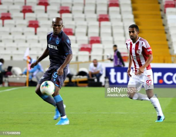 Marcelo of Demir Grup Sivasspor in action against Nwakaeme of Trabzonspor during a Turkish Super Lig week 5 football match between Demir Grup...