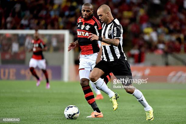 Marcelo of Flamengo struggles for the ball with Diego Tardelli of Atletico MG during a match between Flamengo and Atletico MG as part of Brasileirao...