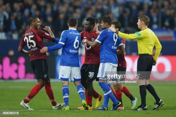 Marcelo of Hannover 96 and KevinPrince Boateng of Schalke 04 argue during the Bundesliga match between FC Schalke 04 and Hannover 96 at VeltinsArena...