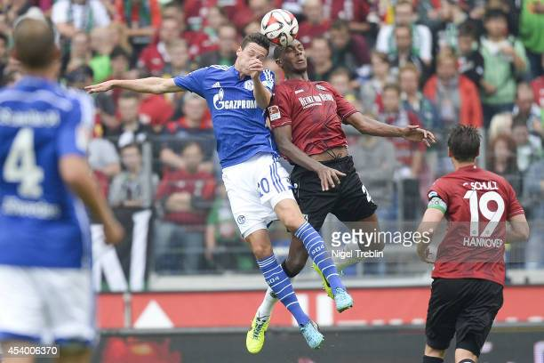 Marcelo of Hannover is challenged by Julian Draxler of Schalke during the Bundesliga match between FC Schalke 04 and Hannover 96 at HDIArena on...