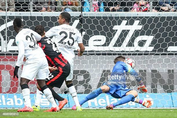Marcelo of Hannover scores his team's first goal against goalkeeper Kevin Trapp of Frankfurt during the Bundesliga match between Eintracht Frankfurt...