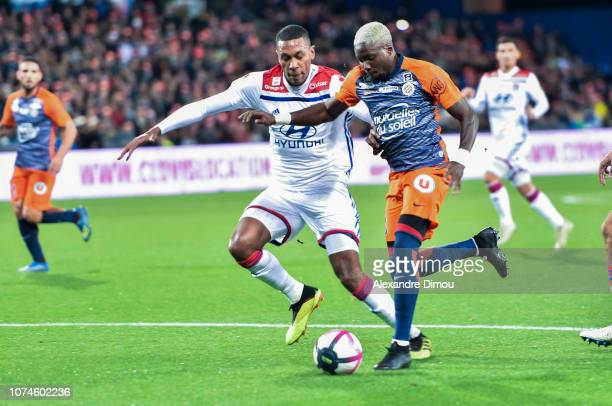 Marcelo of Lyon and Ambroise Oyongo of Montpellier during the Ligue 1 match between Montpellier and Lyon at Stade de la Mosson on December 22 2018 in...