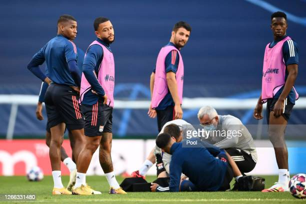 Marcelo of Olympique Lyon goes down injured during the Olympique Lyonnais Training Session ahead of the UEFA Champions League match between...