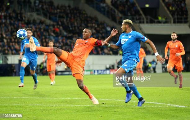 Marcelo of Olympique Lyonnais is challenged by Joelinton of 1899 Hoffenheim during the Group F match of the UEFA Champions League between TSG 1899...