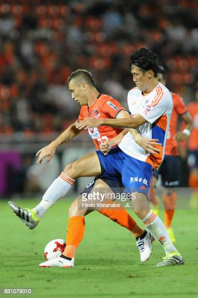 Marcelo of Omiya Ardija and Kisho Yano of Albirex Niigata compete for the ball during the JLeague J1 match between Omiya Ardija and Albirex Niigata...