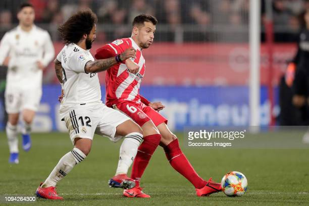 Marcelo of Real Madrid Alex Granell of Girona during the Spanish Copa del Rey match between Girona v Real Madrid at the Estadi Municipal Montilivi on...