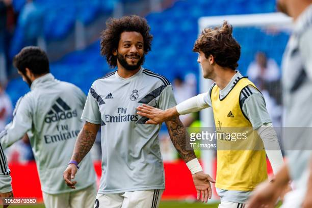 Marcelo of Real Madrid and Alvaro Odriozola of Real Madrid smile during the La Liga match between Real Madrid CF and Levante UD at Estadio Santiago...