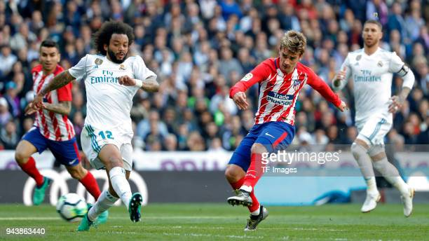 Marcelo of Real Madrid and Antoine Griezmann of Atletico Madrid battle for the ball during the La Liga match between Real Madrid and Atletico Madrid...