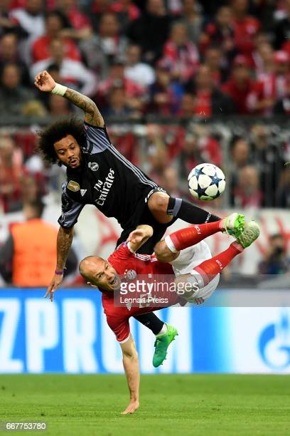 Marcelo of Real Madrid and Arjen Robben of Bayern fight for the ball during the UEFA Champions League Quarter Final first leg match between FC Bayern...