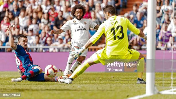 Marcelo of Real Madrid and goalkeeper Oier Olazabal of Levante battle for the ball during the La Liga match between Real Madrid CF and Levante UD at...