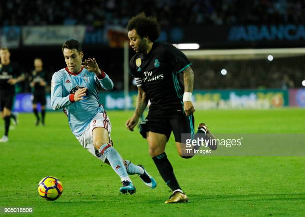 Marcelo of Real Madrid and Hugo Mallo of Celta Vigo battle for the ball during the La Liga match between Celta de Vigo and Real Madrid at Estadio de...