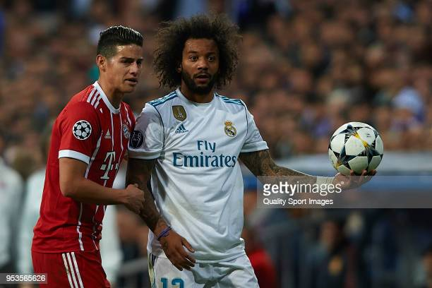 Marcelo of Real Madrid and James Rodriguez of Bayern Muenchen during the UEFA Champions League Semi Final Second Leg match between Real Madrid and...