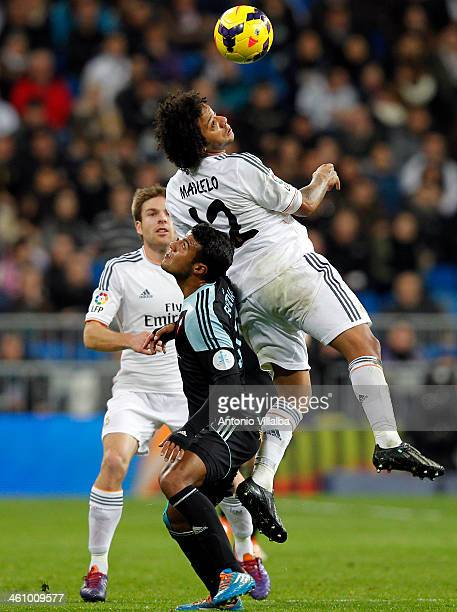 Marcelo of Real Madrid and Rafinha fight the ball during the La Liga match between Real Madrid and RC Celta de Vigo at Estadio Santiago Bernabeu on...