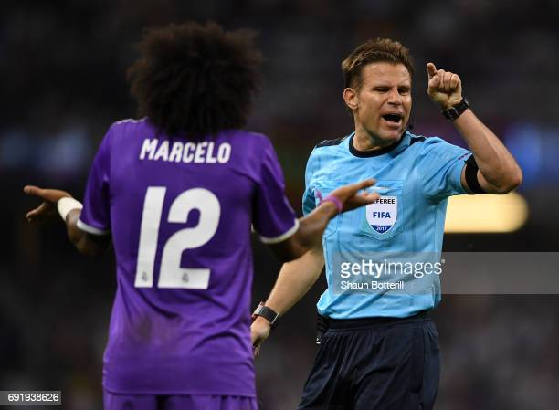 Marcelo of Real Madrid and referee Felix Brych argue during the UEFA Champions League Final between Juventus and Real Madrid at National Stadium of...