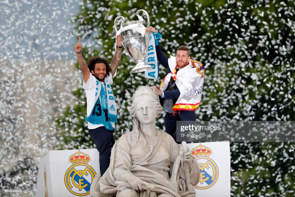 Marcelo of Real Madrid and Sergio Ramos of Real Madrid celebrate with the trophy after winning yesterday's Uefa Champions League Final match at Cibeles Square on May 27, 2018 in Madrid, Spain.