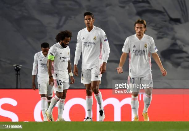 Marcelo of Real Madrid and teammates look dejected after conceding a third goal during the UEFA Champions League Group B stage match between Real...