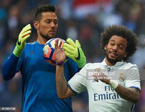 Marcelo of Real Madrid argues for the ball with Diego Alves of Valencia during the La Liga match between Real Madrid CF and Valencia CF at Estadio...
