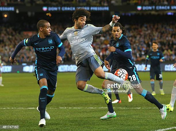 Marcelo of Real Madrid attempts to kick the ball infront of Fernado of Manchester City during the International Champions Cup match between Real...