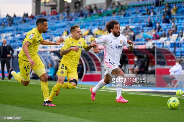 Marcelo of Real Madrid battle for the ball with Ruben Pena of Villarreal CF during the La Liga Santander match between Real Madrid and Villarreal CF...