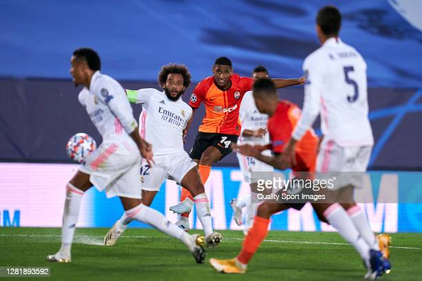 Marcelo of Real Madrid battle for the ball with Tete of Shakhtar Donetsk during the UEFA Champions League Group B stage match between Real Madrid and...