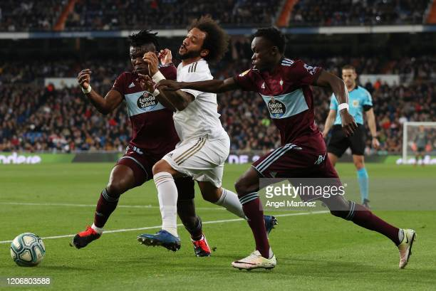 Marcelo of Real Madrid battles for possession with Joseph Aidoo and Pione Sisto of Celta de Vigo during the Liga match between Real Madrid CF and RC...