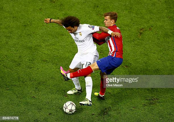 Marcelo of Real Madrid battles for the ball with Antoine Griezmann of Atletico Madrid during the UEFA Champions League Final match between Real...
