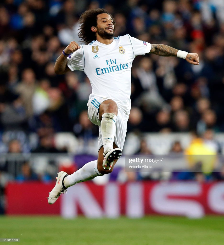 Marcelo of Real Madrid celebrates after scoring during the UEFA Champions League Round of 16 First Leg match between Real Madrid and Paris Saint-Germain at Estadio Santiago Bernabeu on February 14, 2018 in Madrid, Spain.