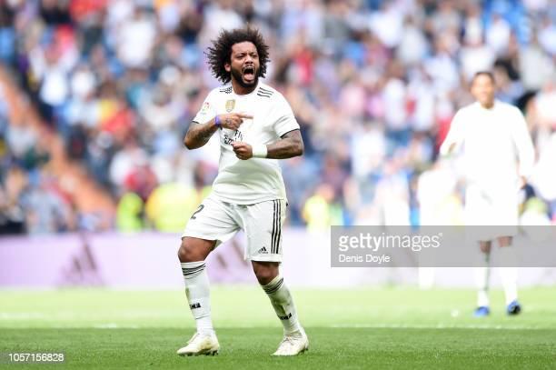 Marcelo of Real Madrid celebrates after scoring his sides first goal during the La Liga match between Real Madrid CF and Levante UD at Estadio...