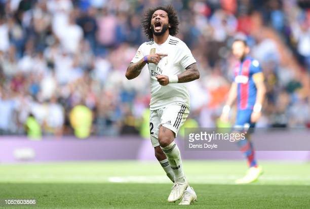 Marcelo of Real Madrid celebrates after scoring his teams opening goal during the La Liga match between Real Madrid CF and Levante UD at Estadio...