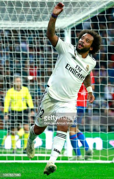 Marcelo of Real Madrid celebrates after scoring his team's second goal during the Group G match of the UEFA Champions League between Real Madrid and...