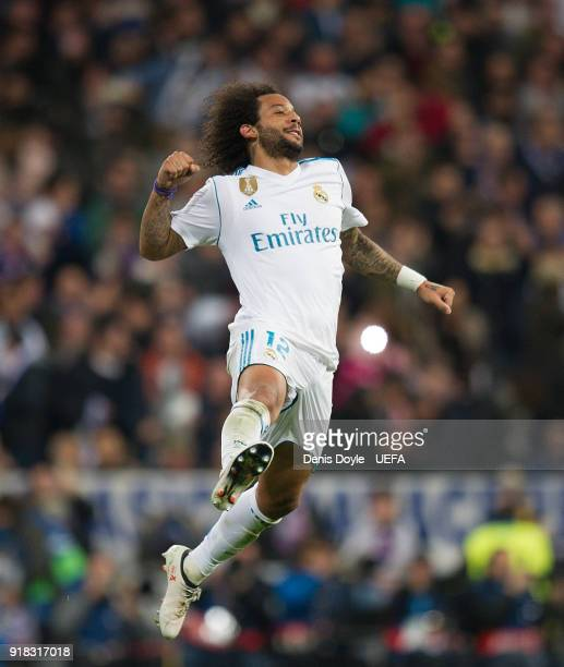 Marcelo of Real Madrid celebrates after scoring his team's third goal during the UEFA Champions League Round of 16 First Leg match between Real...