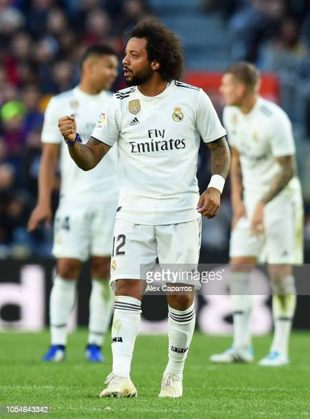 Marcelo of Real Madrid celebrates as he scores his sides first goal during the La Liga match between FC Barcelona and Real Madrid CF at Camp Nou on...
