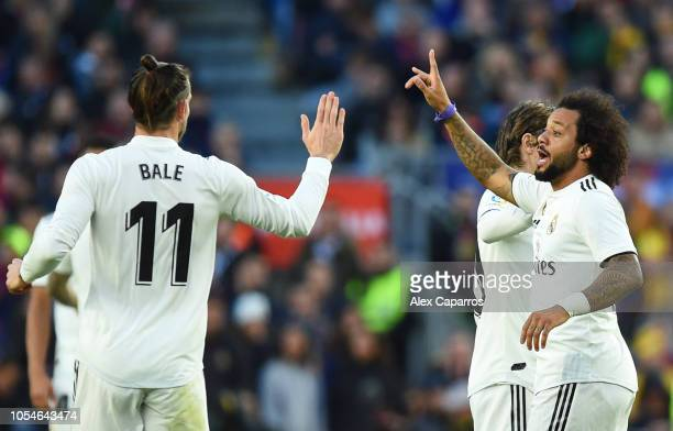 Marcelo of Real Madrid celebrates as he scores his sides first goal with Gareth Bale of Real Madrid during the La Liga match between FC Barcelona and...