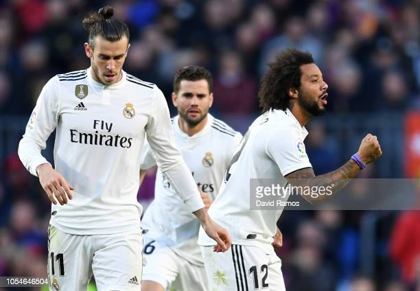 Marcelo of Real Madrid celebrates as he scores his sides first goal with team mates during the La Liga match between FC Barcelona and Real Madrid CF...