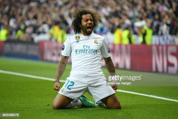 Marcelo of Real Madrid celebrates as Karim Benzema of Real Madrid scores his sides first goal during the UEFA Champions League Semi Final Second Leg...