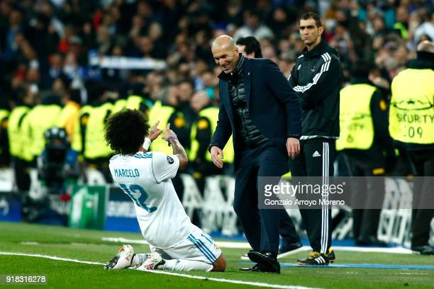 Marcelo of Real Madrid celebrates scoring the 3rd Real Madrid goal with Zinedine Zidane of Real Madrid during the UEFA Champions League Round of 16...