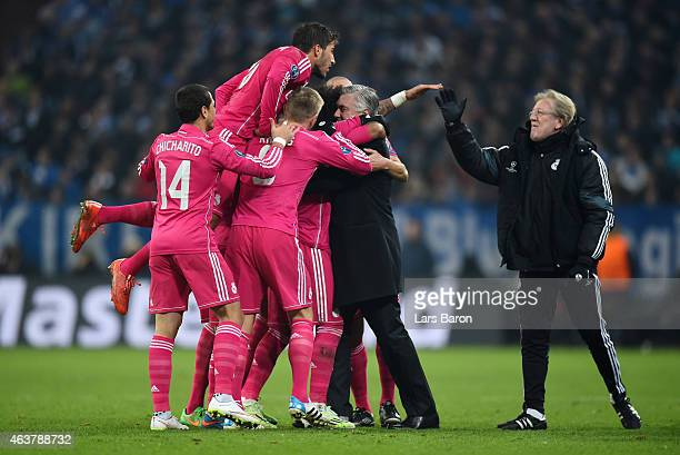 Marcelo of Real Madrid celebrates with Carlo Ancelotti the head coach of Real Madrid and teammates after scoring his team's second goal during the...