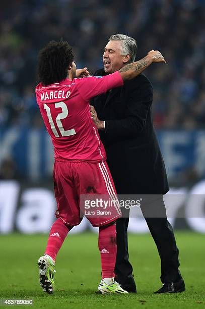 Marcelo of Real Madrid celebrates with Carlo Ancelotti the head coach of Real Madrid after scoring his team's second goal during the UEFA Champions...