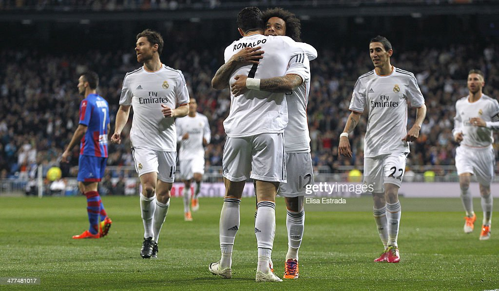 Marcelo of Real Madrid celebrates with Cristiano Ronaldo after scoring during the La Liga match between Real Madrid and Levante UD at Estadio Santiago Bernabeu on March 9, 2014 in Madrid, Spain.