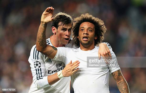 Marcelo of Real Madrid celebrates with Gareth Bale as he scores their third goal during the UEFA Champions League Final between Real Madrid CF and...