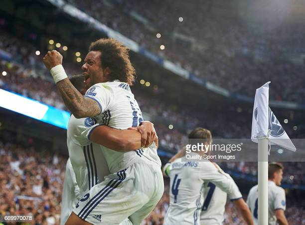 Marcelo of Real Madrid celebrates with his teammates a goal during the UEFA Champions League Quarter Final second leg match between Real Madrid CF...