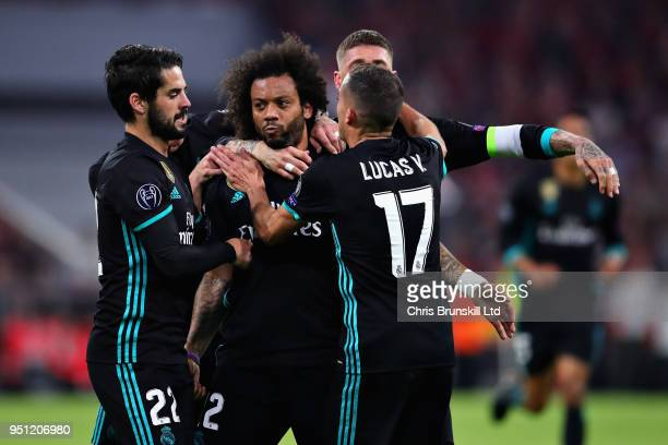 Marcelo of Real Madrid celebrates with his teammates after scoring his sides first goal during the UEFA Champions League Semi Final First Leg match...