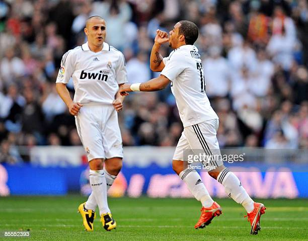 Marcelo of Real Madrid celebrates with team mate Fabio Cannavaro after scoring Madrid's first goal during the La Liga match between Real Madrid and...
