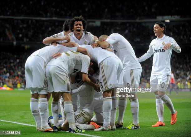 Marcelo of Real Madrid celebrates with teammates after Cristiano Ronaldo scored his team's second goal during the La Liga match between Real Madrid...