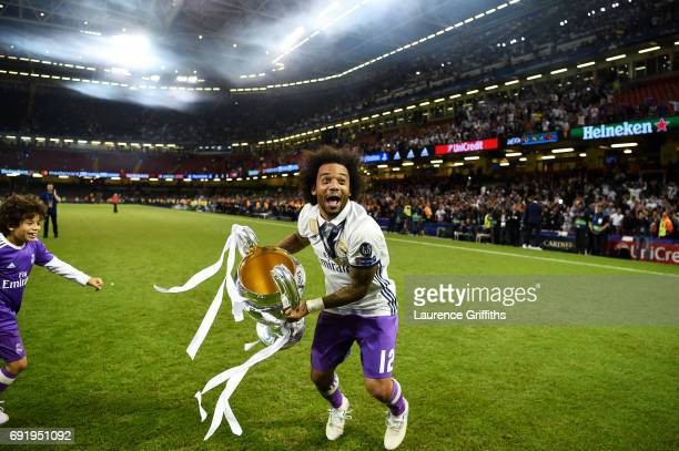 Marcelo of Real Madrid celebrates with The Champions League trophy after the UEFA Champions League Final between Juventus and Real Madrid at National...