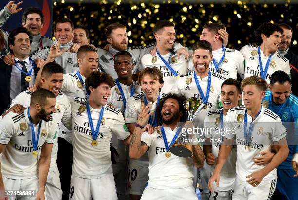 Marcelo of Real Madrid celebrates with the FIFA Club World Cup trophy at the end of the FIFA Club World Cup UAE final match between Real Madrid and...