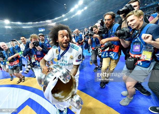 Marcelo of Real Madrid celebrates with The UEFA Champions League trophy following his sides victory in the UEFA Champions League Final between Real...