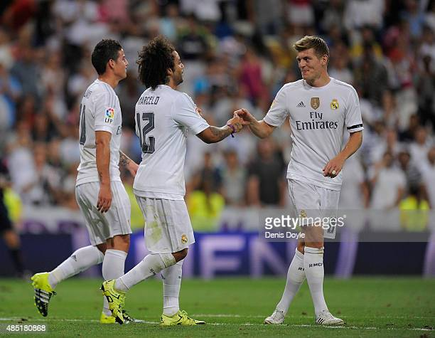 Marcelo of Real Madrid celebrates with Toni Kroos after scoring his team's 2nd goal during the Santiago Bernabeu Trophy match between Real Madrid and...
