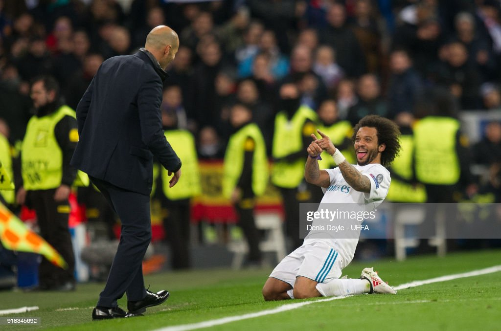 Marcelo of Real Madrid celebrates with Zinedine Zidane, Manager of Real Madrid after scoring his teamÕs third goal during the UEFA Champions League Round of 16 First Leg match between Real Madrid and Paris Saint-Germain at Bernabeu on February 14, 2018 in Madrid, Spain.